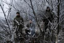 ARTEMIVSK, UKRAINE - FEBRUARY 15: Ukrainian soldiers conduct operations along the road leading to the embattled town of Debaltseve on February 15, 2015. A ceasefire began at midnight between Pro-Russian Separatists and the Ukrainian forces brokered by the EU, Russia and Ukraine. Debaltseve has become the focal point with reportedly 8000 Ukrainian forces trapped in a bottleneck inside the city.