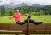 German chancellor Angela Merkel speaks with U.S. president Barack Obama at Schloss Elmau hotel near Garmisch-Partenkirchen, southern Germany, Monday June 8, 2015 during the G-7 summit. (Michaek Kappeler/Pool Photo via AP)