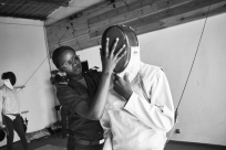 Prison guard Fatoumata Sy assists a boy with his mask, part of a group of minors incarcerated at a nearby prison participating in a fencing session at a studio in the city of Thiès, Senegal on April 14, 2015. Supported by OSIWA, organisation 'Pour un sourire d'enfant' has implemented the sport of fencing as a form of restorative justice in a minor's prison for males and females in the city of Thiès, Senegal. This innovative judicial method works as a restorative rather than punitive approach to justice. Fencing is an effective method for helping incarcerated young people build self-confidence and respect (both for themselves and others), and engender discipline and determination.
