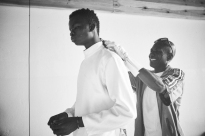 Daouda, 17 years old dresses in preparation for a fencing match at a studio in the city of Thiès, Senegal on April 28, 2015. Supported by OSIWA, organisation 'Pour un sourire d'enfant' has implemented the sport of fencing as a form of restorative justice in a minor's prison for males and females in the city of Thiès, Senegal. This innovative judicial method works as a restorative rather than punitive approach to justice. Fencing is an effective method for helping incarcerated young people build self-confidence and respect (both for themselves and others), and engender discipline and determination.